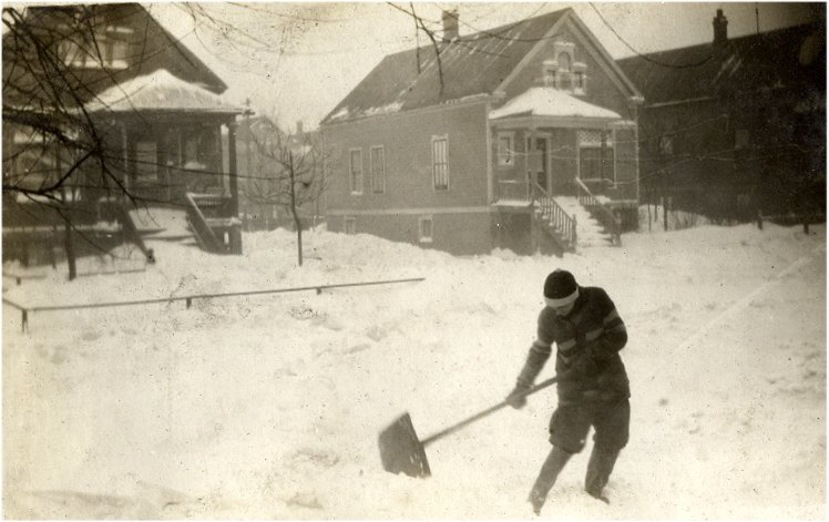 Dot shoveling out to the street in front of 3149.